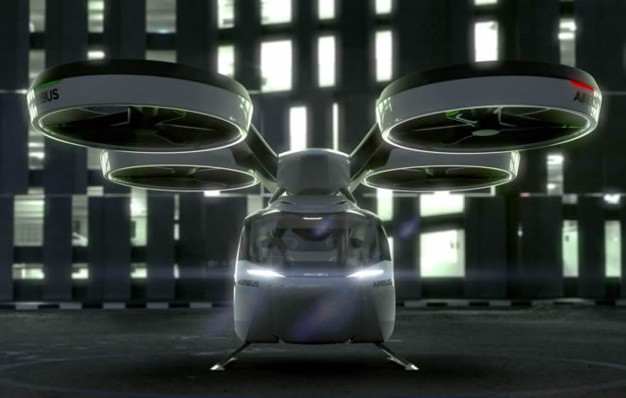 An artists impression of an eVTOL preparing to take off in fornt of a skyscraper