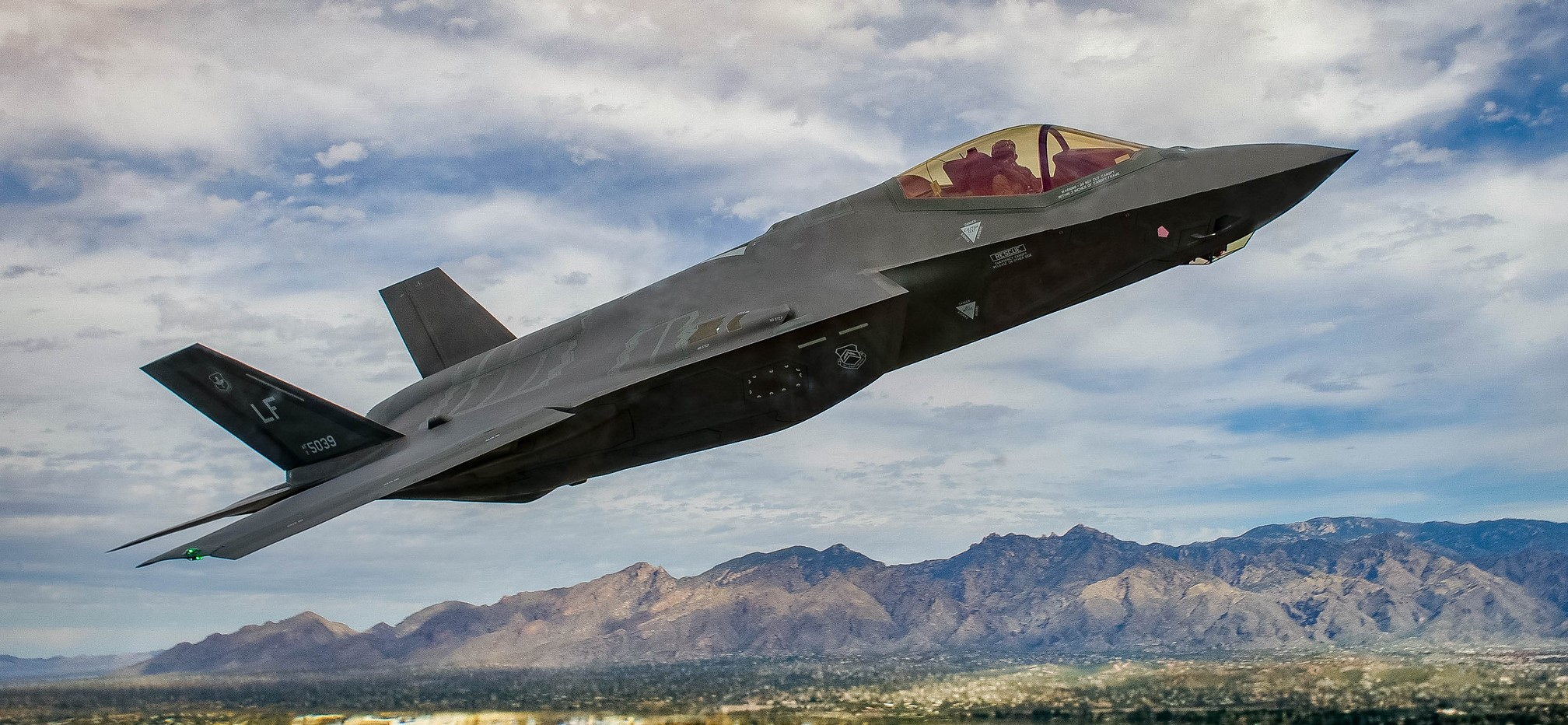 An F-35 Lightening II flies around the airspace of Davis-Monthan Air Force Base on March 5, 2016. The F-35 was participating in Air Combat CommandÕs Heritage Flight Training Course, a program that features modern fighter/attack aircraft flying alongside Word War II, Korean War, and Vietnam War-ear aircraft. (U.S. Air Force photo by Tech. Sgt. Brandon Shapiro)