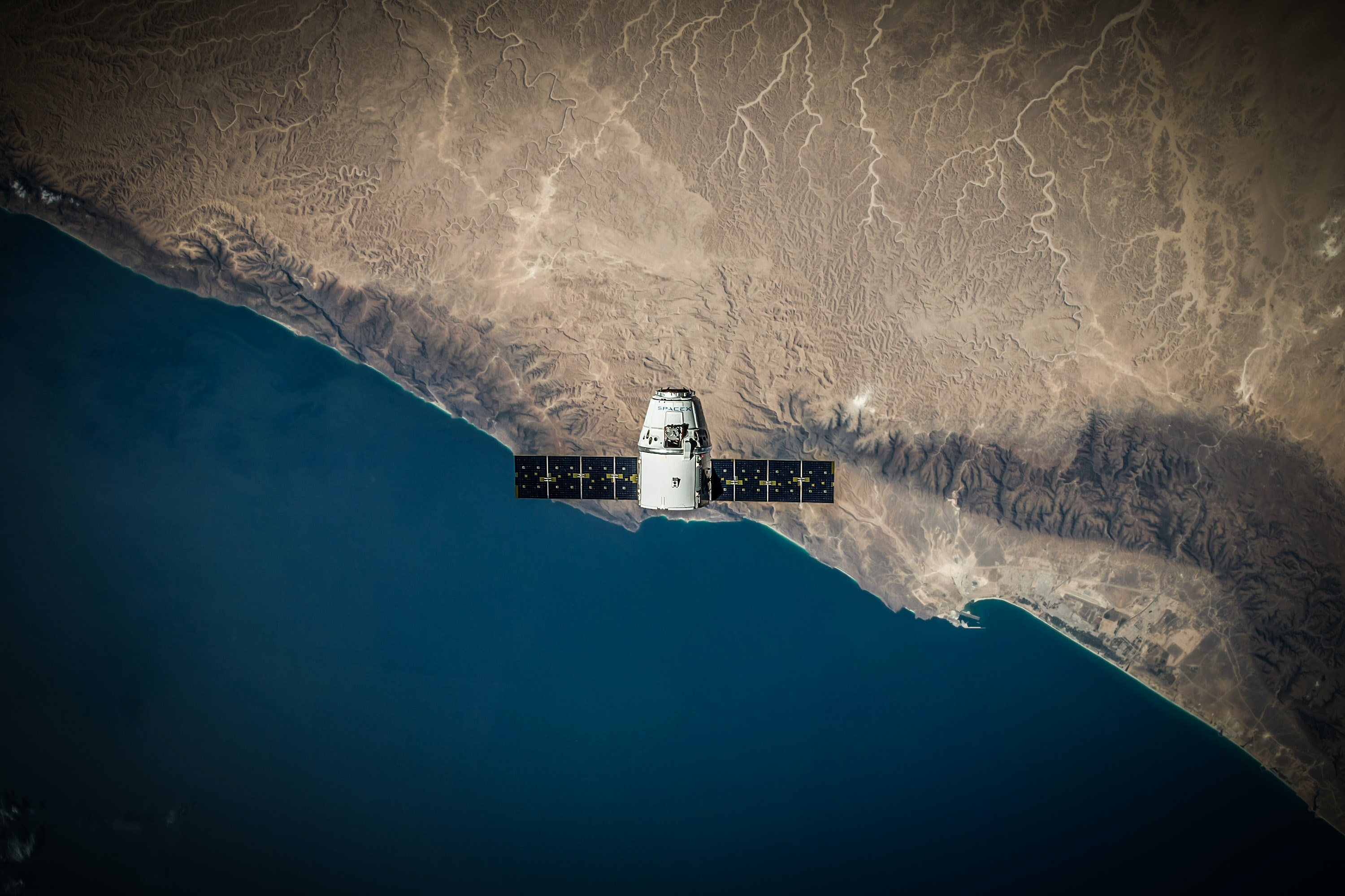 A birds-eye view of a spacex satellite travelling over Earth